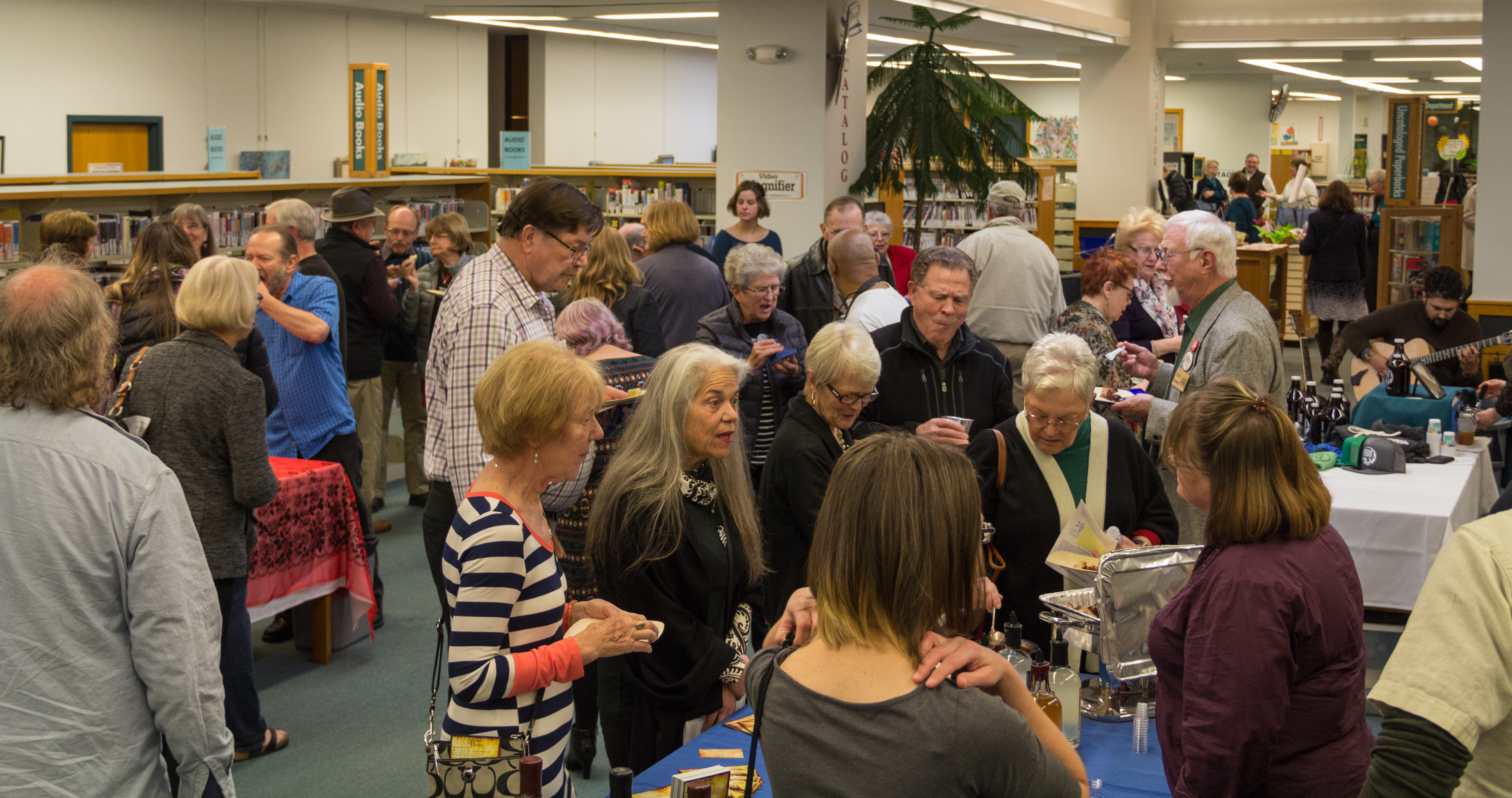 people at library fundraiser
