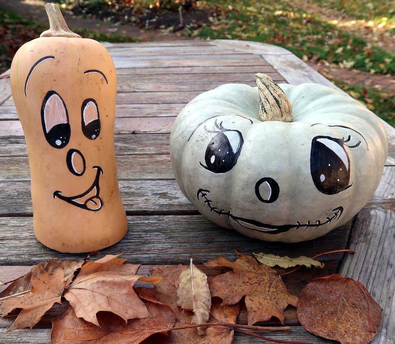 Pumpkins with painted faces.