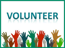 "Hands reaching up toward word ""Volunteer"""