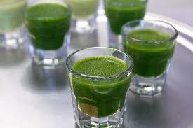 Pic of green superfood drink in shot glasses